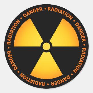 Gul/orange utstrålningssymbolklistermärke runt klistermärke