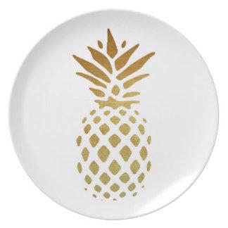 Guld- ananas, frukt i guld tallrik