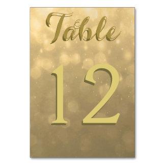 Guld- Bokeh ljus Bordsnummer