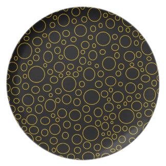 Guld- cirklar pläterar tallrik