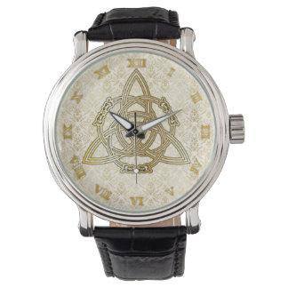 Guld- drake som är tri-Quatra på den guld- Armbandsur