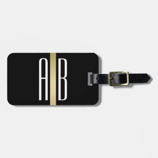 Guld fodrar den svart bagagemärkren för monogramen bagagebricka