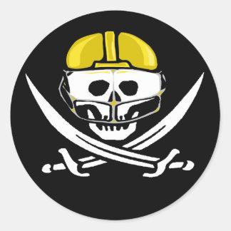 Guld- fotbollsspelareskalle och svärd runt klistermärke