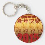 Guld- getter -1 - kinesiskt nytt år 2015 nyckel ringar