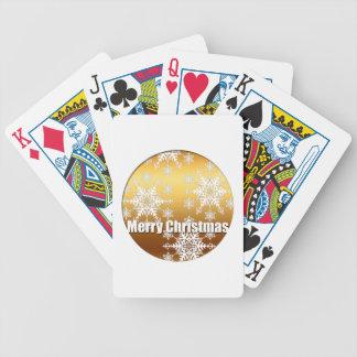 Guld- god julsnöflingor som leker kort spelkort