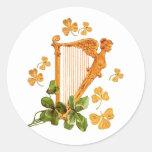 Guld- irländsk harpa runt klistermärke
