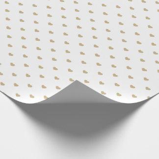 Guld- kärlekhjärtor för jul på vit presentpapper