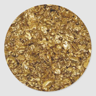 Guld- klumpar runt klistermärke