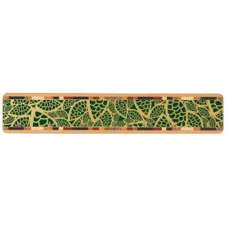 Guld- lövsnöre på grön bakgrund nyckelhängare