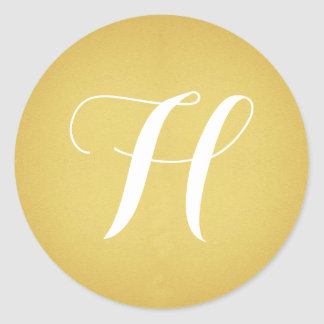 Guld med monogramen runt klistermärke