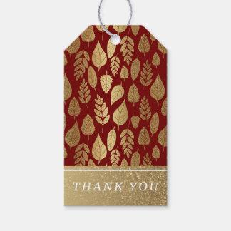 Guld- och rött lövmönster presentetikett