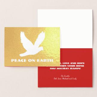 Guld omkullkastar fred på jordjul folierat kort