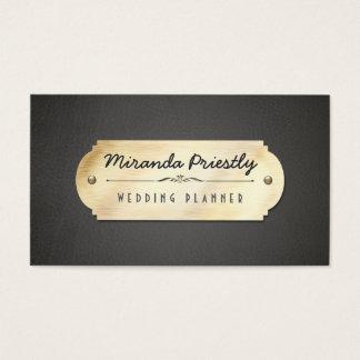Guld pläterar visitkorten för Blak läderbakgrund Visitkort