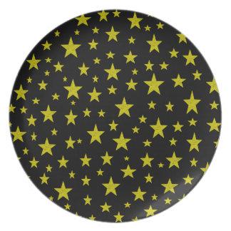 Guld- stjärnor pläterar tallrik