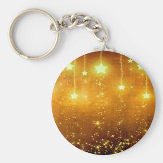 Guld- stjärnor rund nyckelring