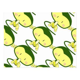 Gullig apa som äter en banan vykort