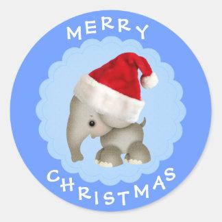 Gullig elefant i klistermärkear för jul för Santa Runt Klistermärke