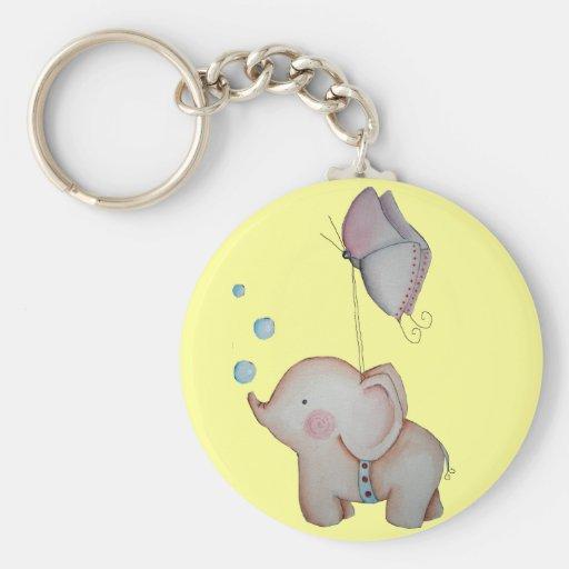 Gullig elefant med fjärilsnyckelringen nyckelringar