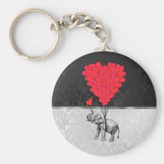 Gullig elefant- och kärlekhjärta på grått rund nyckelring
