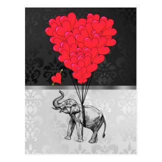 Gullig elefant- och kärlekhjärta på grått vykort