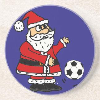 Gullig jultomten som leker fotbolljultecknaden underlägg sandsten