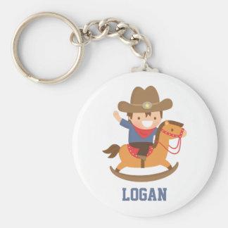 Gullig lite Cowboy på att vagga hästen Keychain Rund Nyckelring