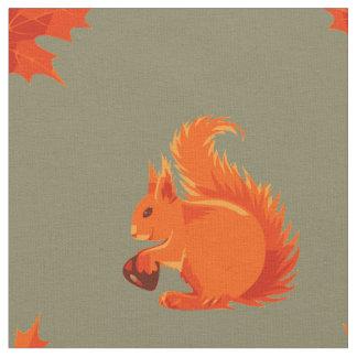 Gullig röd ekorre med kastanjebruna och röda löv tyg