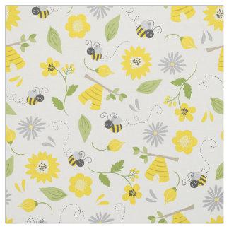 Gulliga bin och blommönster tyg