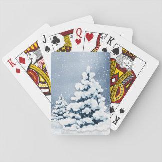 Gulliga snöig grästräd som leker kort spel kort