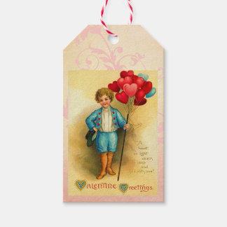 Gulliga valentinballonghälsningar som hänger kort