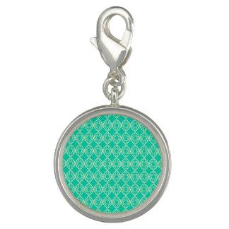 Gult mönster med grön bakgrund berlocker