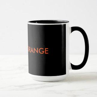 Ha en orange kaffemugg