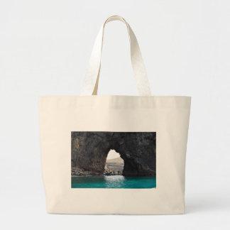 Hål i sten i hav tygkasse