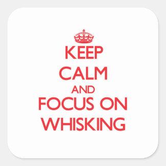 Håll lugn och fokusera på att vifta fyrkantigt klistermärke