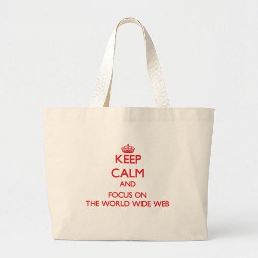 Håll lugn och fokusera på world wide web tote bags
