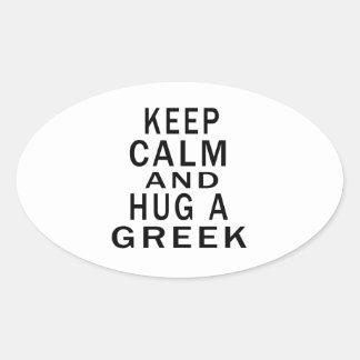 Håll lugn och krama en grek ovalformat klistermärke