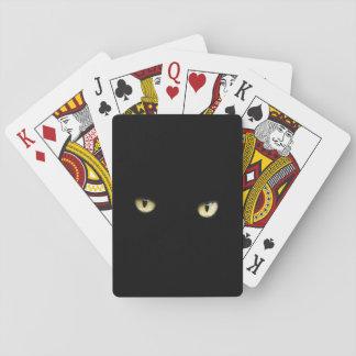 Halloween svart kattögon som leker kort kortlek