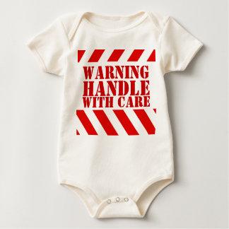 Handtag för nyfödd bebisvarningsrandar med omsorg bodies för bebisar