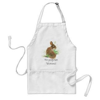 Handtag några ogräs som arbeta i trädgården, kanin förkläde