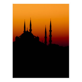 Härlig silhouette av en moské på solnedgången vykort