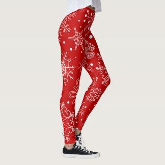 Härlig snöflingor på röd bakgrundsjul leggings