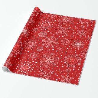 Härlig snöflingor på röd bakgrundsjul presentpapper