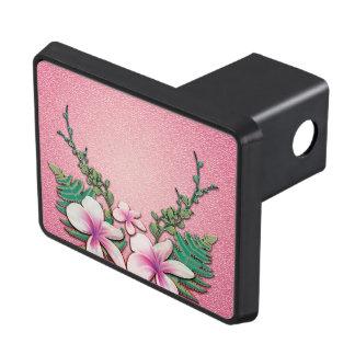 Härliga blommor på mjuk rosa bakgrund dragkroksskydd