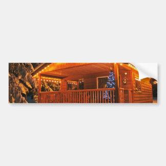 Härligt julljus loggar på kabinen i snö bildekal