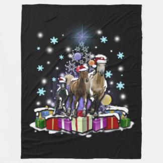 Hästar med julstilar fleecefilt