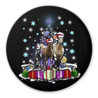 Hästar med julstilar knopp