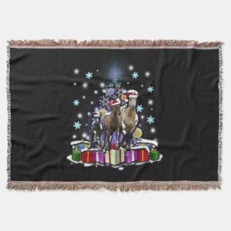 Hästar med julstilar mysfilt