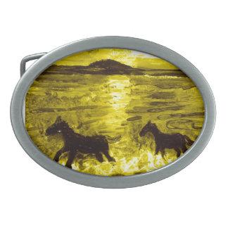 Hästar på en guld- Seashore