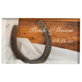 Hästsko- och satänglandsbyggsbröllop bordskorthållare