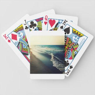 Hav och strand på skymningen spelkort